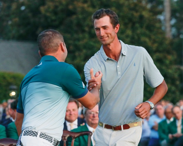 Sergio Garcia, of Spain, lefts, shakes hands with low amateur Stewart Hagestad of Newport Beach after the Masters golf tournament, Sunday, April 9, 2017, in Augusta, Ga. (AP Photo/Chris Carlson)