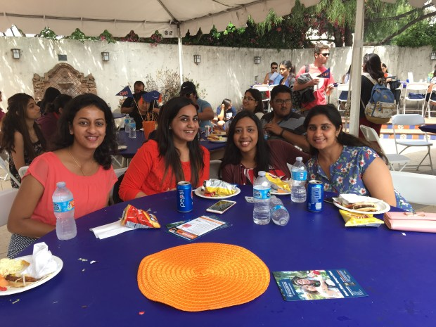 Shwetha Patil of Santa Ana, Sanjana Purohit of Irvine, Bhavya Sreenivasa Murthy of Covina and Daaman Behal of Artesia, from left, all receiving their master's degrees in software engineering, enjoy the Cal State Fullerton Grad BBQ on April 27 at Golleher Alumni House. (Photo courtesy of Cal State Fullerton)