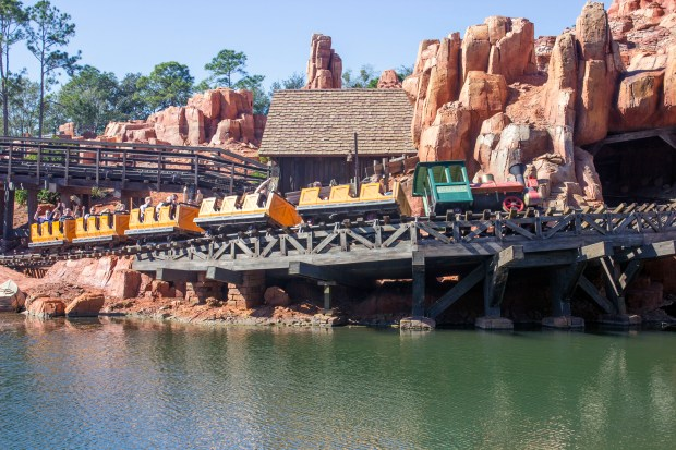 The train takes a high speed banked turn on a trestle over the waters of the Rivers of America aboard the Big Thunder Mountain Railroad in Frontierland at the Magic Kingdom of Walt Disney World. (Photo by Mark Eades, Orange County Register/SCNG)