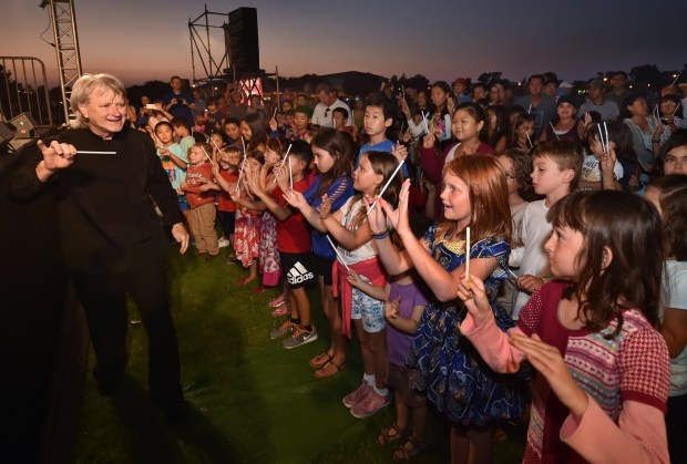 Longtime Pacific Symphony music director Carl St.Clair will reach kids how to conduct an orchestra before a Symphony in the Cities concert on July 19 at Mike Ward Community Park in Irvine. (File photo by Steven Georges, contributing photographer)