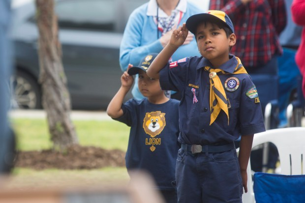 From right, eight-year-old Aaron Rooke and his 5-year-old brother Ryan Rooke salute the U.S. flag as it is raised by Fountain Valley Police Explorers during a Memorial Day Ceremony on Monday, May 29, 2017. (Photo by Drew A. Kelley, Contributing Photographer)