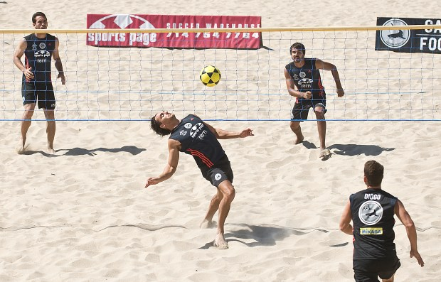 Professional footvolley teams compete in the California Footvolley World Championships at Huntington Beach. The sport combines soccer and volleyball. NICK AGRO/ ORANGE COUNTY REGISTER
