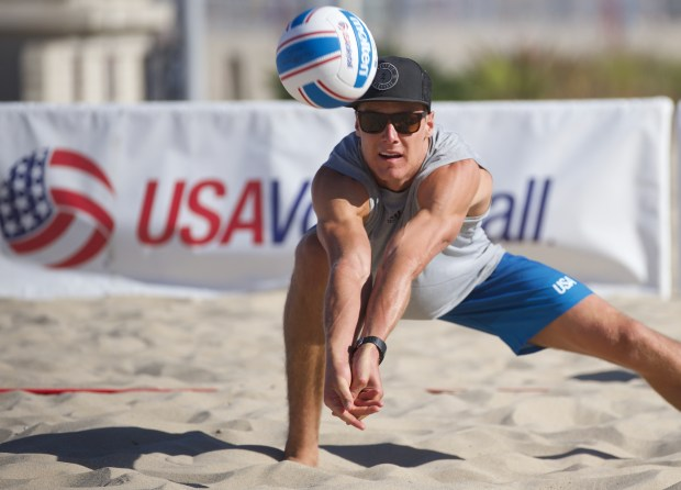 USC's Lucas Yoder of San Clemente reaches for this dig during the USA Collegiate Beach Championships May 13 in Hermosa Beach. (USAV/Matt A. Brown)