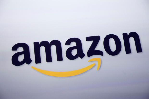 Retail giant Amazon is hunting for a second headquarters that would need some 5-8 million square feet of space for its staff. (AP Photo/Mark Lennihan, File)