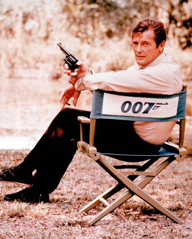 British actor Roger Moore, playing the title role of secret service agent 007, James Bond, is shown on location in England in 1972. Moore, played Bond in seven films, more than any other actor. Roger Moore's family said Tuesday May 23, 2017 that the former James Bond star has died after a short battle with cancer (AP Photo, File)