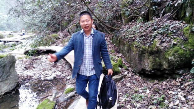"In this photo from March 2016 and released by Deng Guilian, Li Zhao is seen at a scenic spot in Nanzhang county, Xianyang city, in central China's Hubei province. Li is one of three men involved in investigating working conditions at a Chinese factory that produces Ivanka Trump-brand shoes who have been arrested or gone missing, a family member and an advocacy group said Tuesday, May 30, 2017. China Labor Watch Executive Director Li Qiang said he lost contact with Hua Haifeng and the other two men, Li Zhao and Su Heng, over the weekend. By Tuesday, after dozens of unanswered calls, he had concluded: ""They must be held either by the factory or the police to be unreachable."" (Deng Guilian via AP) ORG XMIT: XHG202"
