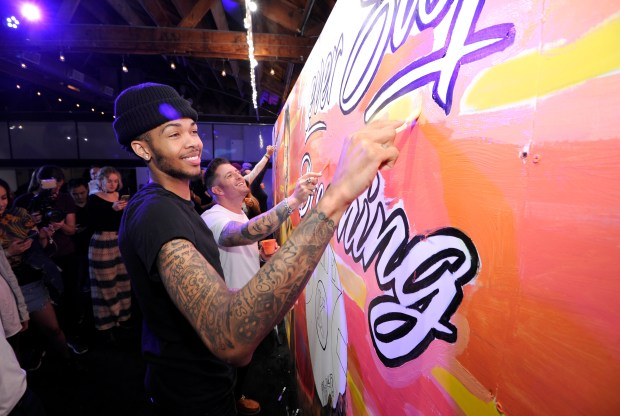 """VENICE, CA - MARCH 11: (L-R) Los Angeles Lakers' Brandon Ingram and iconic street artist Jonas Never atttend Delta's first """"Beyond The Court Event"""" to create billboard display together with fans at The Rose Room on March 11, 2017 in Venice, California. (Photo by John Sciulli/Getty Images for Delta)"""