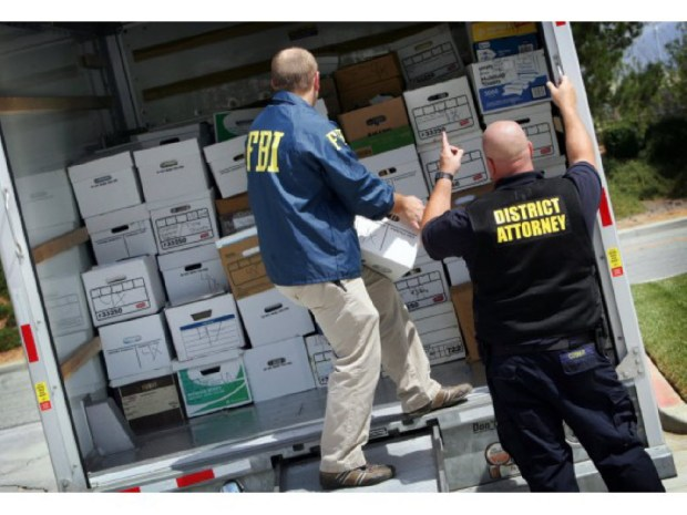 FBI and Riverside County district attorney investigators load boxes of evidence collected during a series of raids in April 2015 tied to a Beaumont corruption probe.