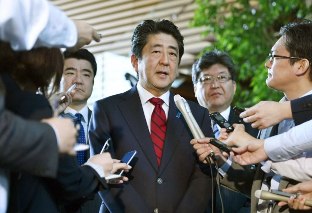Japanese Prime Minister Shinzo Abe, center, answers to a reporter's question about North Korea's missile launch, at his official residence in Tokyo Monday morning, May 29, 2017. North Korea on Monday fired an apparent ballistic missile off its east coast that landed in the waters of Japan's economic zone, South Korean and Japanese officials said, the latest in a string of recent test launches as the North seeks to build nuclear-tipped ICBMs that can reach the U.S. mainland. (Muneyuki Tomari/Kyodo News via AP) ORG XMIT: TKMY801