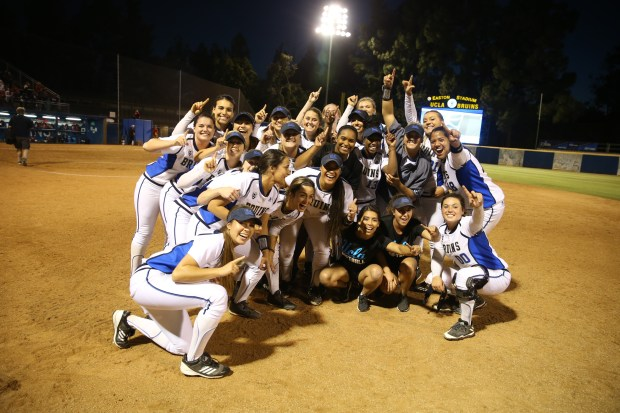 UCLA softball players celebrate their 1-0 win over No. 12 Mississippi on Friday at Easton Stadium that sent them to the Women's College World Series. (Photo courtesy Katie Meyers)