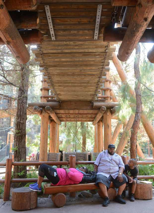 Alina Sam, her husband Henry Sam and their son, Christian Sam, 8, from Gilbert, Arizona, relax in the shade at Redwood Creek Challenge Trail in Disney's California Adventure in Anaheim, California, on Wednesday, June 28, 2017.(Photo by Jeff Gritchen, Orange County Register/SCNG)