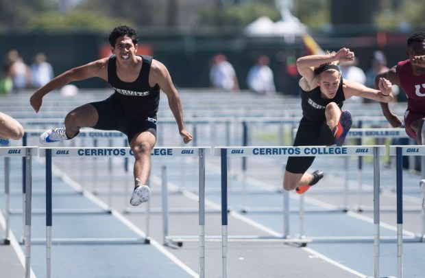 Servite's Kyle Sandoval, left, edges ahead of teammate Ian Ward during the Division 3 110 meter hurdles during the CIF-SS Track Championships at Cerritos College in Norwalk, on Saturday, May 20, 2017. (Photo by Nick Agro, Orange County Register/SCNG)