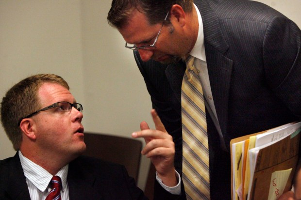 ORG XMIT: POSTMUS24WLB.JPGJuly 23, 2009 San Bernardino Metro Former San Bernardino County Assessor Bill Postmus, left, talks with attorney James Knox, right, in Superior Court in San Bernardino have been arraigned on nine felony counts, including grand theft, misuse of public funds, and drug paraphernelia possession. Postmus was order to posted $100,000 dollars bail and report to West Valley Detention Center to be booked and released. (William Wilson Lewis III/The Press-Enterprise)