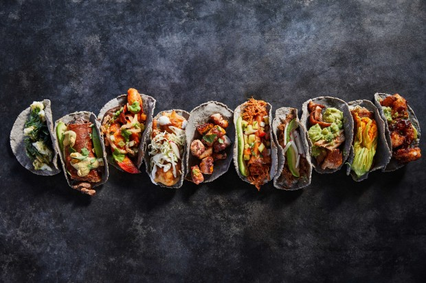 Puesto: Half the tacos on the menu come layered with crisp melted cheese.