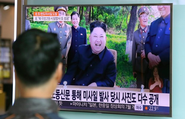 A man watches a TV news program showing image of North Korean leader Kim Jong Un, published in the North Korea's Rodong Sinmun newspaper, at Seoul Railway station in Seoul, South Korea, Monday, May 22, 2017. North Korea fired a solid-fuel ballistic missile Sunday that can be harder for outsiders to detect before launch and later said the test was hailed as perfect by leader Kim Jong Un. (AP Photo/Lee Jin-man) ORG XMIT: LJM101