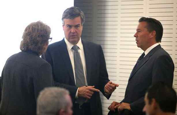 Attorneys Stephen Larson, middle, and Jennifer Keller, left, discuss their case with defendant Jeff Burum, one of four defendants currently on trial in San Bernardino County's Colonies corruption trial. FILE PHOTO