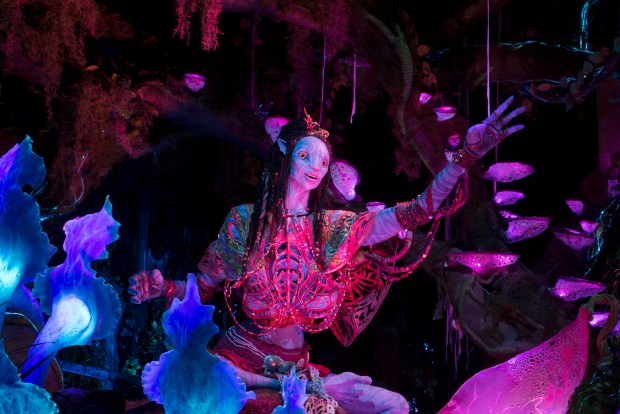 A Na'vi Shaman of Song sings her songs connecting her to the moon of Pandora, inside the Na'vi River Journey attraction that is part of the newest land at Disney's Animal Kingdom: Pandora: The World of Avatar at Walt Disney World. (Photo courtesy: The Walt Disney World Resort)