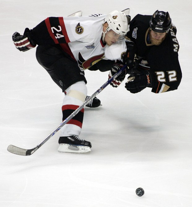 Ottawa's Anton Volchenkov shoves Ducks Todd Marchant during the third period of game one of the Stanley Cup Finals at the Honda Center in Anaheim.