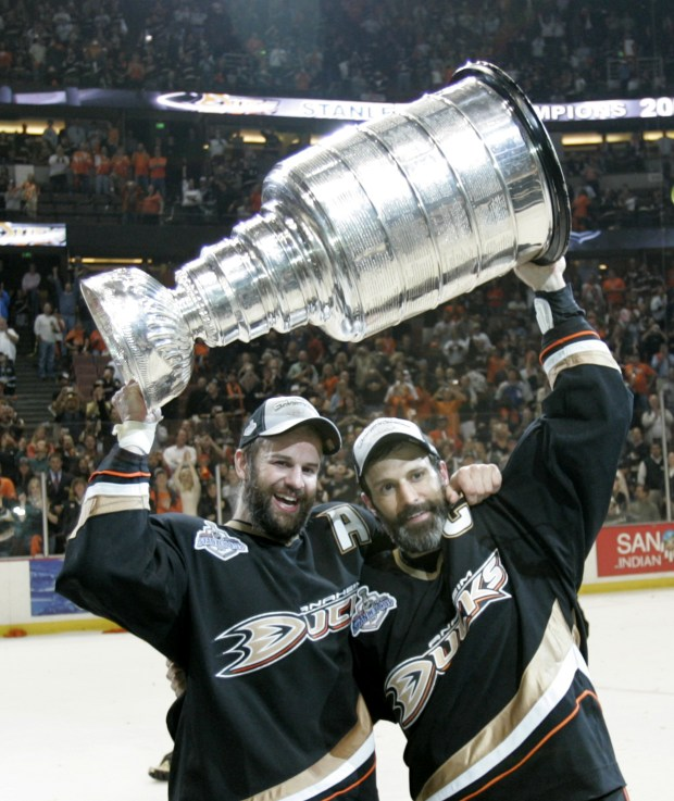 c1bebc6037d Rob Niedermayer, left, and his brother, Scott Niedermayer hoist the Stanley  Cup after they defeated the Ottawa Senators in Game 5 of the Stanley Cup  Final ...