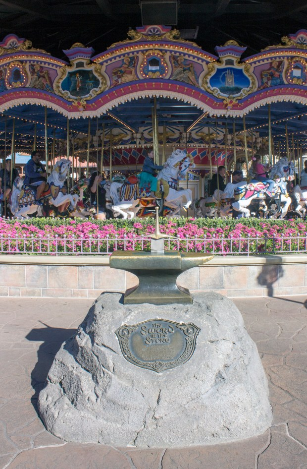 "Excalibur sits in stone like in the Disney animated movie ""The Sword in the Stone"" in front of the Prince Charming Regal Carrousel in Fantasyland at the Magic Kingdom of the Walt Disney World Resort. (Photo by Mark Eades, Orange County Register/SCNG)"