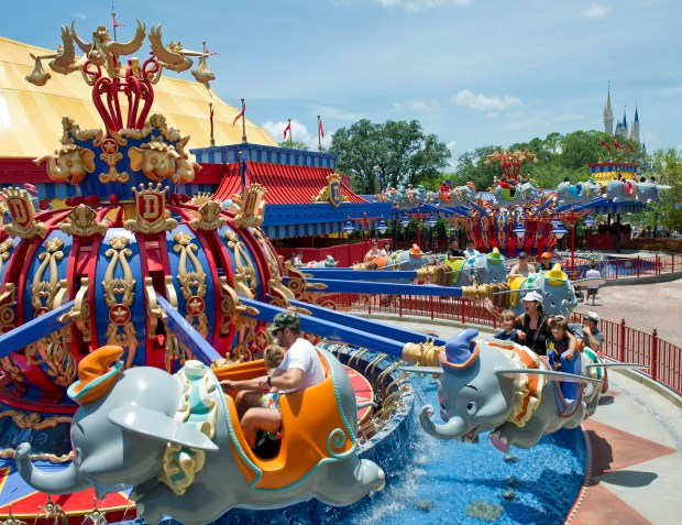 Riders slow for a landing on Dumbo, the Flying Elephant, which features two of the rides to increase capacity on the very popular attraction in Fantasyland at Walt Disney World's Magic Kingdom theme park. (Courtesy: The Walt Disney World Resort)