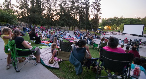 Familes prepare to watch a free movie ie at Arovista Park in Brea. (File photo by Kyusung Gong, Orange County Register/SCNG)