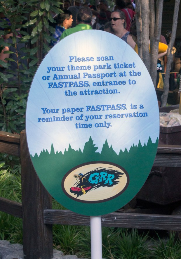 Signs at Disneyland Resort attractions inform visitors of the new procedures for Fastpasses. (Photo by Mark Eades, Orange County Register/SCNG)
