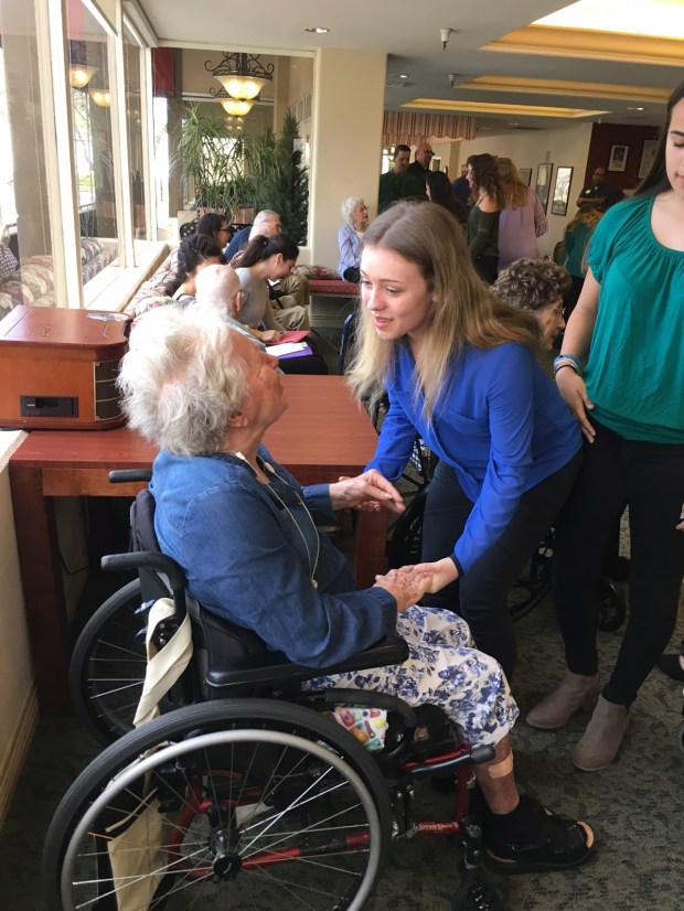 Orange Lutheran High student, Hannah Pink, spends time with a resident at The Chateau on Capitol Hill, a Sacramento retirement home. (Photo courtesy of Orange Lutheran High School)