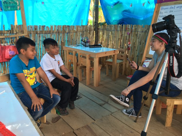 An Orange County School of the Arts student interviews students in a Guatemala elementary school for a short documentary during a trip to the country in April 2017. (Photo courtesy of OCSA)