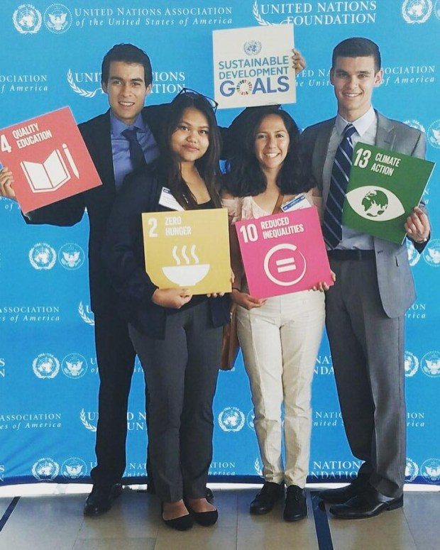 Cal State Fullerton students, from left, Marco Sanchez, Katherine Gorospe, Sara Salinas and Ivan Raspudic hold a few of the U.N.'s 17 Global Goals for Sustainable Development. (Photo courtesy of Marco Sanchez)