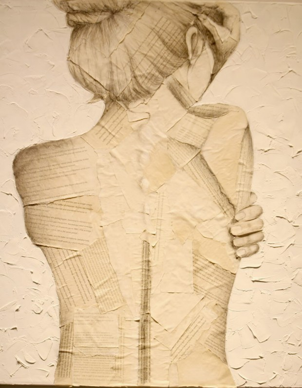 "A piece made by Laguna Beach High School senior, Michaela Bryant, is on display during the K-12 LBUSD Summer Art Exhibit at the Laguna Art Museum. Bryant explains her piece, ""The figure depicted in this piece is positioned in a stance of exposure and vulnerability. The words of the paper scar her back with comments that convey the growing prevalence of body shaming in our society."" (Photo by Ana P. Gutierrez-Garcia, Contributing Photographer)"