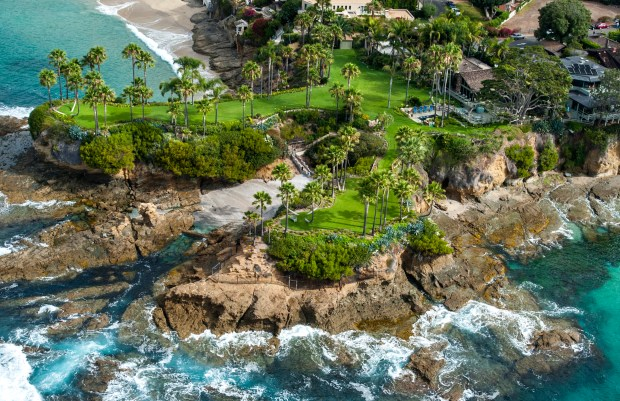 Twin Points, at 1101 Marine Drive in Laguna Beach, is located on a bluff between Crescent Bay and Shaw's Cove.///ADDITIONAL INFORMATION: laguna.aerial - 07/16/15 - MARK RIGHTMIRE, THE ORANGE COUNTY REGISTER A unique Laguna Beach estate with two headlands projecting hundreds of feet into the Pacific Ocean sold today for a record-smashing $45 million. The home was priced at $75 million when it hit the market last June. The price dropped to $65 million in October and $45 million on November 30. A 3-bedroom cottage, originally built in 1928, and a guest house sit on the lush, 2.3-acre parcel between ShawÕs Cove and Crescent Bay.