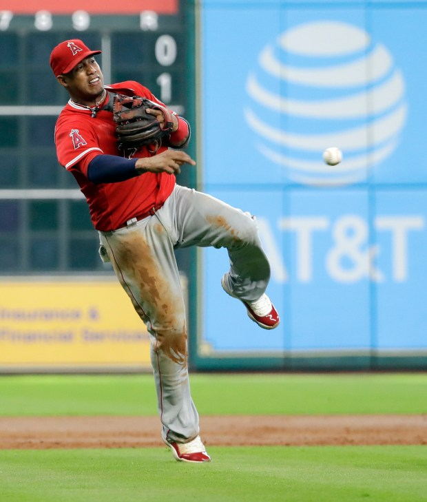 Los Angeles Angels third baseman Yunel Escobar throws to first for an out after fielding a ground ball by Houston Astros' George Springer during the third inning of a baseball game Saturday, June 10, 2017, in Houston. (AP Photo/David J. Phillip) ORG XMIT: TXDP108