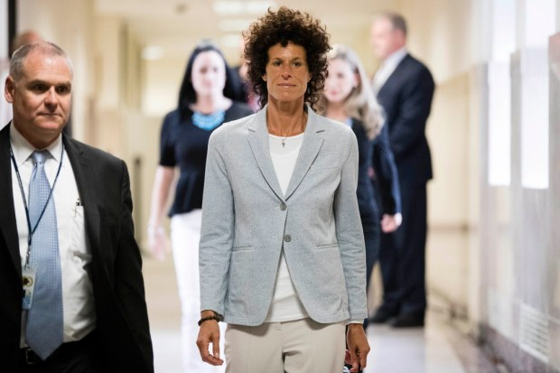 Andrea Constand walks to the courtroom during Bill Cosby's sexual assault trial at the Montgomery County Courthouse in Norristown, Pa., Tuesday, June 6, 2017. Cosby is accused of drugging and sexually assaulting Constand at his home outside Philadelphia in 2004. (AP Photo/Matt Rourke, Pool) ORG XMIT: PAMR116