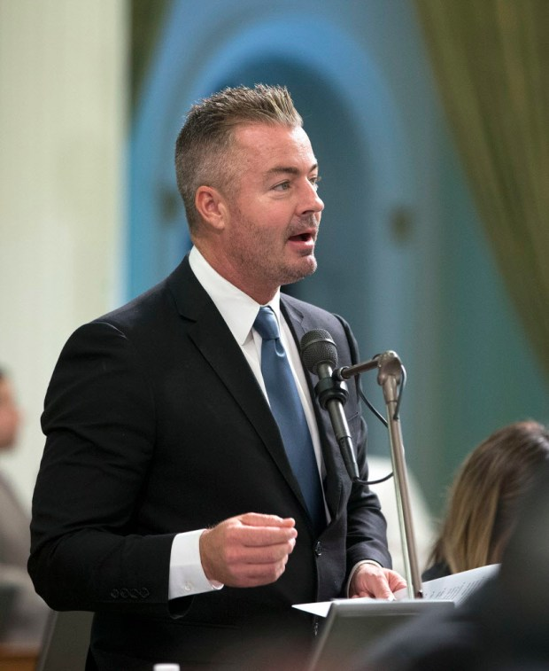 In this Aug. 18, 2016 file photo, California Assemblyman Travis Allen, R-Huntington Beach, addresses the Assembly in Sacramento. (AP Photo/Rich Pedroncelli, file) ORG XMIT: PDX403