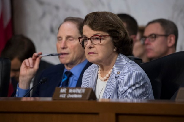 Sen. Dianne Feinstein, D-Calif., right, joined at left by Sen. Ron Wyden, D-Ore., listen as former FBI director James Comey testifies before the Senate Select Committee on Intelligence, on Capitol Hill in Washington, June 8.  (AP Photo/J. Scott Applewhite)