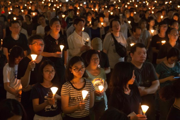Tens of thousands of people attend an annual candlelight vigil at Hong Kong's Victoria Park, Sunday, June 4, 2017. Hong Kongers commemorate victims of the Chinese government's brutal military crackdown nearly three decades ago on protesters in 1989 Beijing's Tiananmen Square. (AP Photo/Kin Cheung) ORG XMIT: XKC105