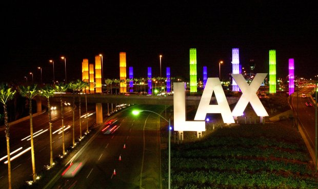 Traffic moves in and out of the newly lit Los Angeles International Airport on Tuesday, Aug. 8, 2000. The event marked the Gateway LAX Enhancement Project by lighting 100-foot-high pylons and 32-foot-high letters spelling out LAX. The entire project including construction and landscaping cost $112 million. (AP Photo/Michael Caulfield)