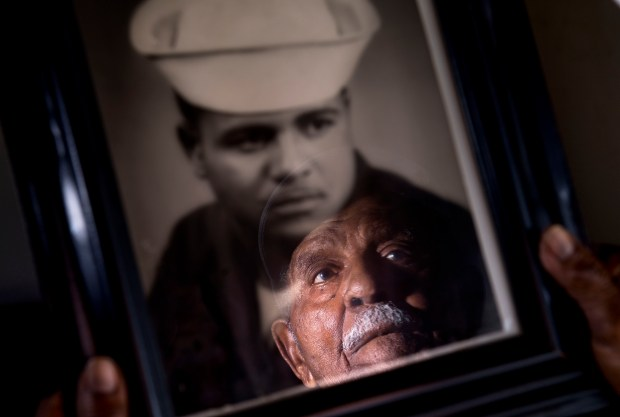 Ray Ross, 90, in Santa Ana holds a photo of himself as a sailor in the US Navy during World War II. Ross is a survivor of the Port Chicago disaster, the massive explosion that ripped through the Navy amunition depot in California on July 17, 1944. (Photo by Paul Rodriguez, Orange County Register/SCNG)