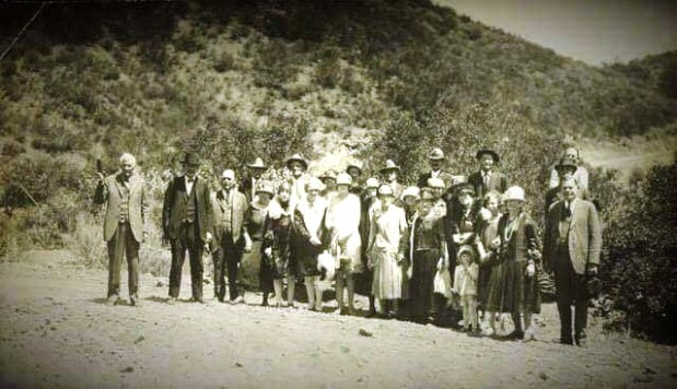 From left, Corona co-founder Robert R.B. Taylor holds a bottle of orange juice as he stands with town pioneers, Corona chamber officials and other residents at the entrance to Tin Mine Canyon during the dedication ceremony for Corona Skyline Drive, now known as Skyline Drive, on May 4, 1927. Hikers and historians will wear 1920s garb to recreate the photo for the road s 90th anniversary on June 10, 2017. (COURTESY OF CORONA PUBLIC LIBRARY -- One time use only. REUSE PERMISSION MUST BE GOTTEN FROM CORONA LIBRARY).