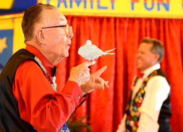 Ed Russell, 81, changed this dove into a cat during a performance of Russell Bros. Family Fun Circus, a staple at the OC Fair for 23 years.///ADDITIONAL INFORMATION: slices.circus.0723 - 7/20/16 - BILL ALKOFER, STAFF PHOTOGRAPHER - The Russell Brothers Family Fun Circus has been a staple at the Orange County Fair for 23 years.