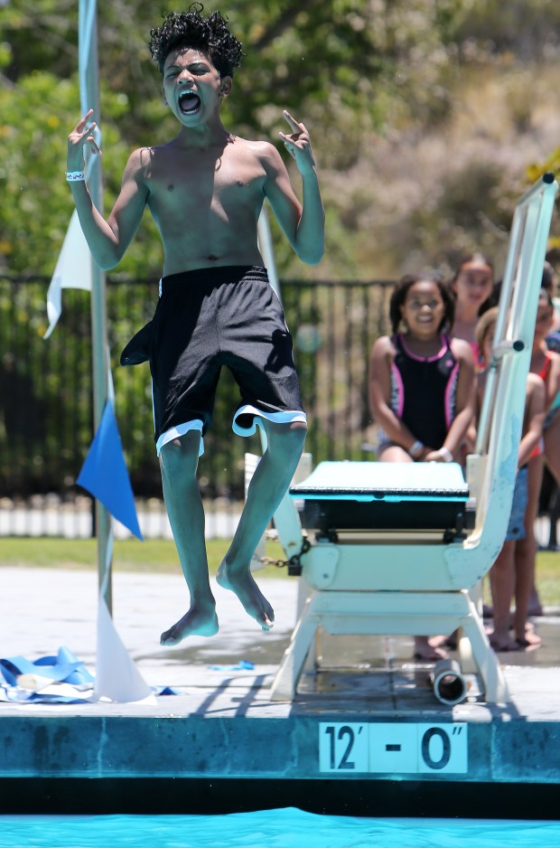 Phoenix Nettles, 13, jumps off the diving board at the Temecula Community Recreation Center swimming pool in Temecula Thursday, June 15, 2017. FRANK BELLINO, THE PRESS-ENTERPRISE/SCNG