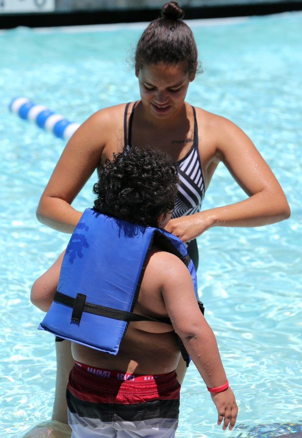 Kirstie Millar, 25, helps her nephew Aaron Hernandez, 4, with a llife vest at the Temecula Community Recreation Center pool in Temecula Thursday, June 15, 2017. FRANK BELLINO, THE PRESS-ENTERPRISE/SCNG