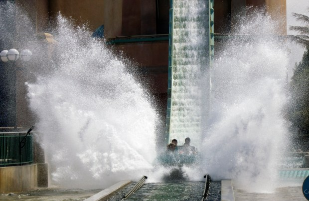 It's a wet splashdown on the Journey to Atlantis ride, that is half roller coaster, and half water ride at SeaWorld San Diego. (Photo by Mark Eades, Orange County Register/SCNG)