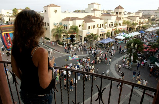 The intersection of Main St. and Olive Ave. is a popular Tuesday gathering place in Downtown Huntington Beach since the advent of Surf City Nights, which outgoing Businenss Improvement District manager Susan Welfringer helped popularize with special events, entertainment and vendors. Photo by Leonard Ortiz / Orange County Register