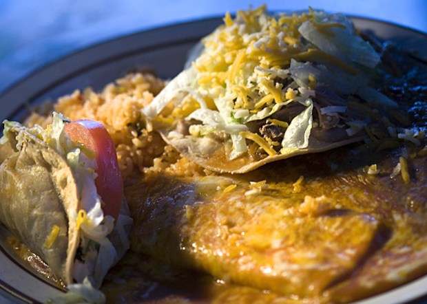 Papa's combo with ground beef taco, cheese enchilada and pork tostada is featured at El Farolito. The Placentia restaurant also offers a Junior-style (one item) or Mama-style (two item) plates. (File photo by Cindy Yamanaka, Orange County Register/SCNG)