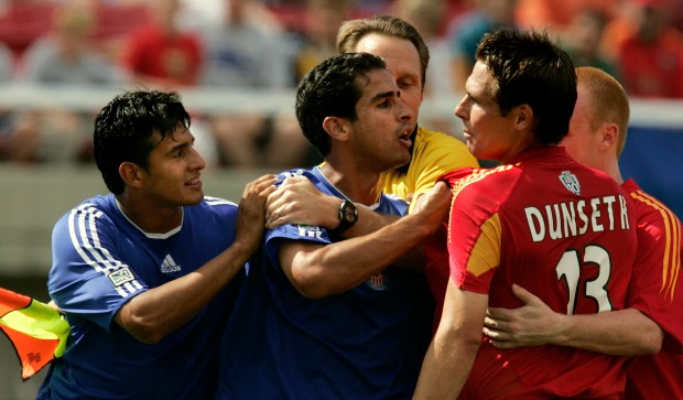 Chivas USA's Esteban Arias, left, goes around teammate Arturo Torres to get to Real Salt Lake defender Brian Dunseth during the first half Saturday, Aug. 6 , 2005, in Salt Lake City. Esteban was given a red card during the shoving match. Real Salt Lake won 2-1. (AP Photo/Douglas C. Pizac)