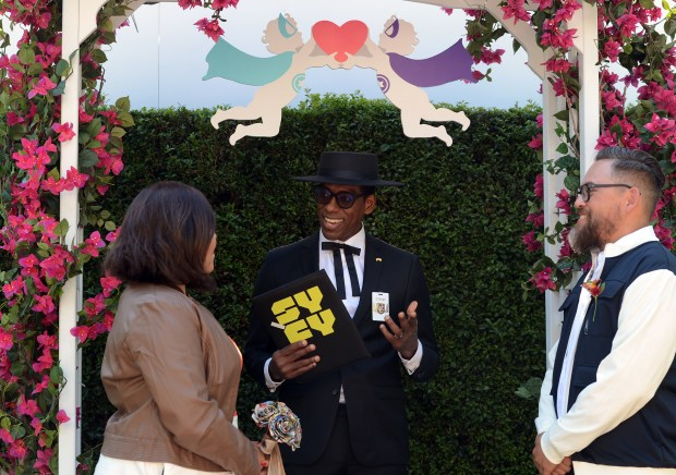 Actor Orlando Jones officiates as Melissa and Esteban Martinez, of San Diego, get married at the SYFY Geek Love Chapel during Comic-Con International in San Diego, CA., Thursday, July 20, 2017. (Staff photo by Jennifer Cappuccio Maher/Southern California News Group)