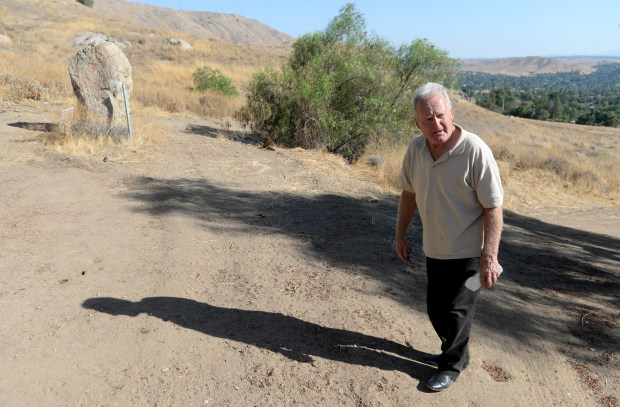 Cary Shuker, of Riverside, walks in the area near his home where he encountered a large coyote like animal, he believes was a chupacabra, Thursday, July 20, 2017. Shuker friend MJ Bunt has also spot this animal they believe is a chupacabra. (Photo by John Valenzuela/The Sun/SCNG)