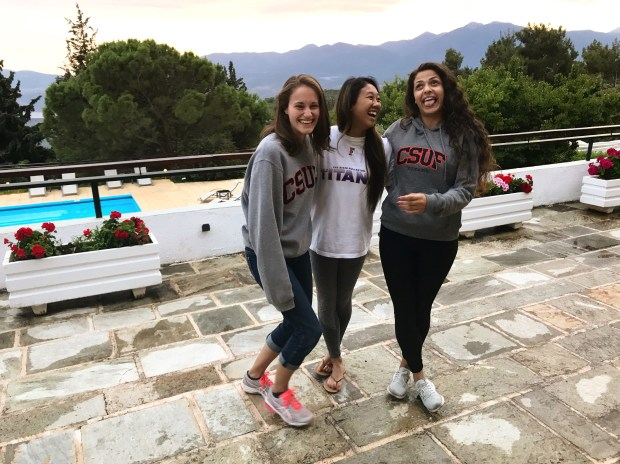 Cal State Fullerton students Katy Johnson, Lindsay Wong and Talia Jankowski share a laugh on their trip to Greece. (Photo courtesy of Talia Jankowski)